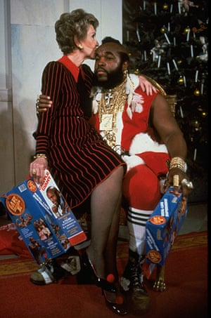 fancy meeting you here 2: First lady Nancy Reagan sitting on lap kissing Mr. T