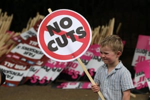 Public sector strikes: A young boy prepares to take part in a march with public sector workers