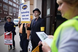 Public sector strikes: Union members hold a placards outside the Department for Education building