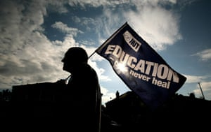Public sector strikes: A teacher forms part of a picket line, Manchester