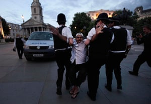 Public sector strikes: An activist in Trafalgar Square is removed by police