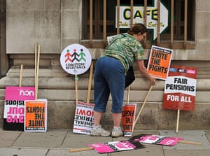 National strikes: A woman arranges placards
