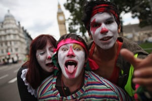 National strikes: People dressed as clows pull faces during march