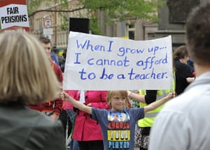 National strikes: Boy holds a banner during a protest over pension reforms in Leeds