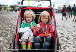 Glastonbury: Children being being pushed toward John Peel stage, Glastonbury festival