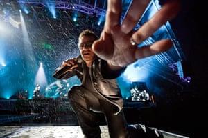 Glastonbury: U2's Bono reaches out to take the photographer's camera, Glastonbury festival
