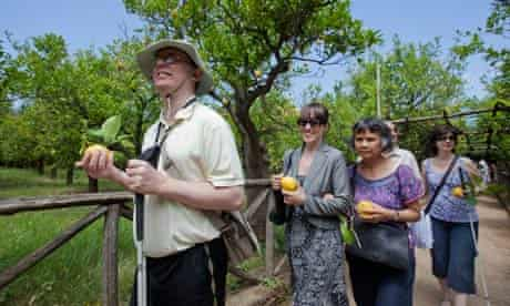The Traveleyes tour group visits a lemon grove in Sorrento.