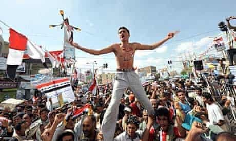 Yemenis celebrate the exit of President Ali Abdullah Saleh to Saudi Arabia for medical treatment
