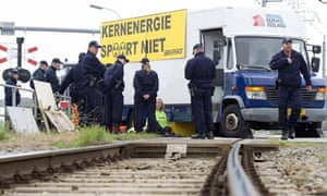 Greenpeace protesters chained to railway tracks in Borssele, the Netherlands