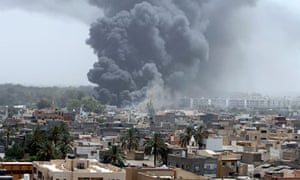 Smoke rises after air strike in Tripoli