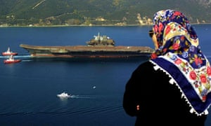 The rusty-looking Varyag aircraft carrier sold by the Ukraine passes through the Bosphorus