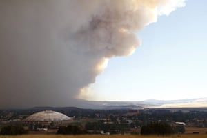 Arizona Wildfires: Smoke from the Wallow Wildfire rises over Round Valley High School Stadium