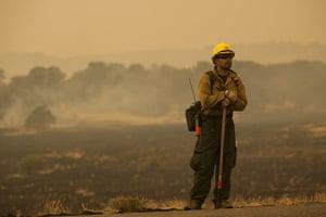 Arizona Wildfires: Firefighter Rigoberto Torres watches a backburn