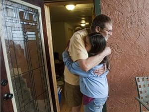 Arizona Wildfires: Tom Hollender gets a hug from neighbour Samatha Earl