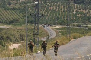 Syrian Refugees: Turkish soldiers patrol the border
