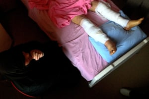 Syrian Refugees: A Syrian woman waits beside her wounded husband