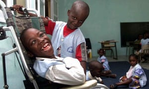 A disabled child and his classmate in Dakar, Senegal.