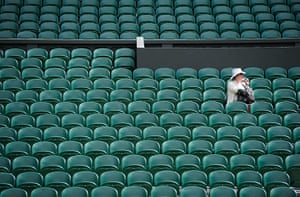 Wimbledon day 11: A lone spectator on Centre Court taking pictures for posterity