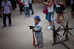 Communist Party 90th: A boy dressed in Communist Red Army, 90th anniversary of Communist Party