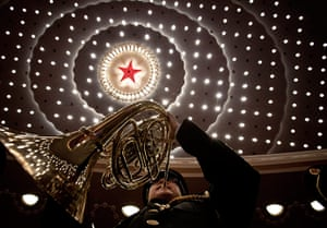Communist Party 90th: A military band member rehearses at the Great Hall of the People
