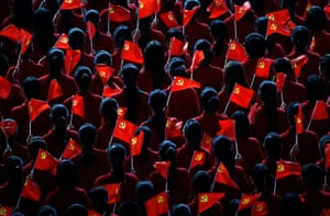 Communist Party 90th: Performers hold flags, 90th anniversary of Communist Party
