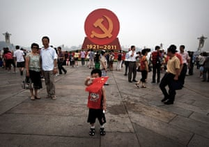 Communist Party 90th: Chinese boy waves a flag, 90th anniversary of Communist Party