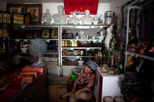 Communist Party 90th: Souvenier shop owner, 90th anniversary of Communist Party