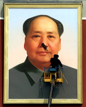 Communist Party 90th: Worker cleans Mao Zedong portrait, 90th anniversary of Communist Party