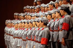 Communist Party 90th: Participants sing during contest, 90th anniversary of Communist Party