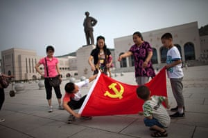 Communist Party 90th: Tourist holding flag in Yan'an, 90th anniversary of Communist Party