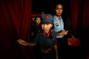 Communist Party 90th: A schoolgirl at singing competition, 90th annversay of Communist party