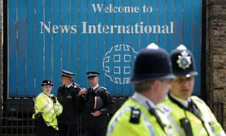 Police outside News International headquarters in Wapping, east London