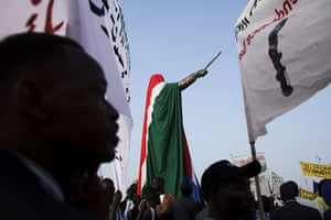 FTA: David Azia: People gather around a statue of former leader John Garang