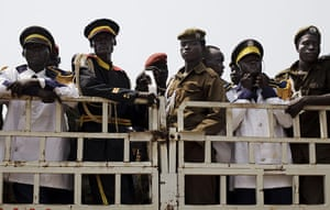 FTA: David Azia: Southern Sudanese police officers and members of a band on a truck