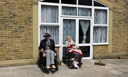 Residents sit outside a Southern Cross home