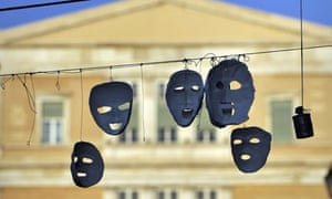 Masks hang in Syntagma Square in Athens, which remains occupied by protesters