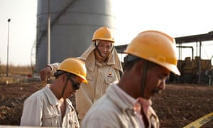 Workers for the China Petroleum Engineering & Construction Corp (CPECC) in Sudan