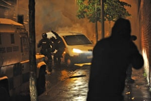 Belfast riots: Police try to break into a burning car