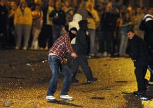 Belfast riots: Rioters move forward to attack police lines with rocks