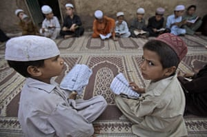 24 hours in pictures: Boys attend a religious class in a mosque  inIslamabad, Pakistan