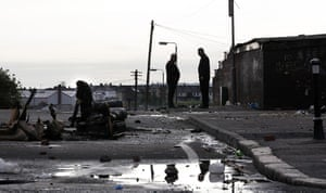 Ardoyne riots: Two men stand near the road the morning after riots in the Ardoyne