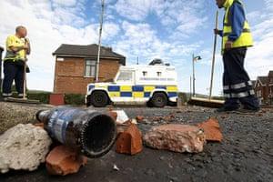 Ardoyne riots: Workers sweep as a large clean up operation gets underway in Ardoyne