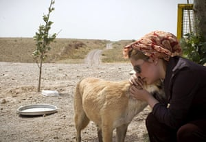 FTA: Behrouz Mehri: An Iranian woman caresses a mother stray dog who lost her puppies