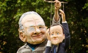 Protestor dressed as Rupert Murdoch