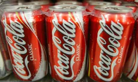 coca-cola cans on the shelf