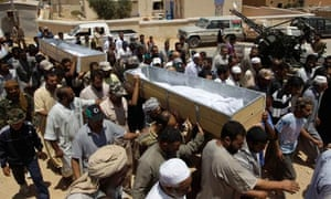 Mourners carry the coffin of a Libyan rebel fighter in Zintan
