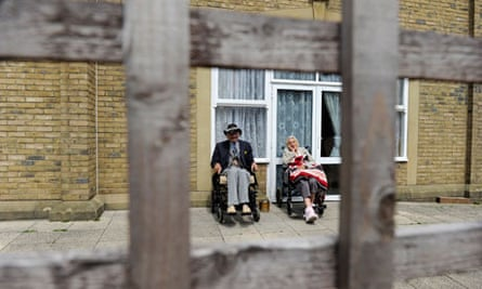 Residents sit outside a Southern Cross care home in Camberwell Green in south London
