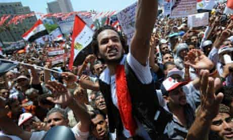 Egyptian protesters wave their national flag and shout slogans in Cairo's Tahrir Square