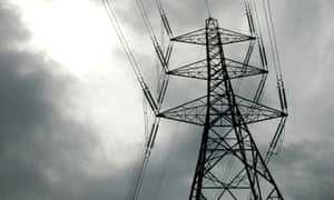 An electricity pylon is pictured near Cobham in Surrey, southern England