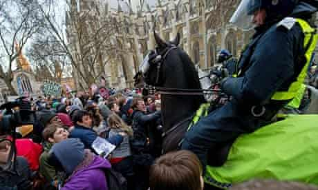 Mounted police drive their horses into protesters during student demonstrations in London